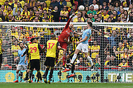 Heurelho Gomes (1) of Watford punches the ball away from Aymeric Laporte (14) of Manchester City  during the The FA Cup Final match between Manchester City and Watford at Wembley Stadium, London, England on 18 May 2019.