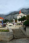 Town square Kacicev trg, and church. Makarska, Croatia