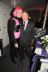 JULIAN FELLOWES and his wife EMMA KITCHENER-FELLOWES at a party to celebrate the publication of 'Past Imperfect' by Julian Fellowes held at Cadogan Hall, 5 Sloane Terrace, London SW1 on 4th November 2008.