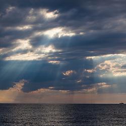 A fishing trawler under storm clouds at Duck Harbor Beach in Wellfleet, Massachusetts. Cape Cod.