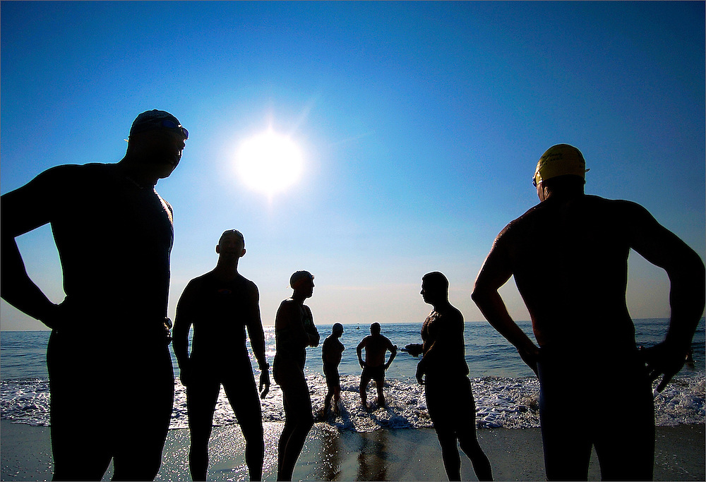 Participants test the waters before competing in the third annual 1-mile Ocean Swim held at the Monmouth Beach Bathing Pavilion in Monmouth Beach on Saturday, July 26.  The Monmouth Beach Beautification Committee held the annual event to raise money for park and beautification projects within Monmouth Beach. Photo essay from throughout the Jersey Shore, New Jersey