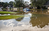 Flooded police car in Denham Springs Louisiana where over two feet of rain fell in 48 hours caused historic flooding.