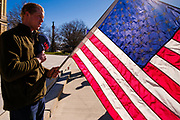 """28 NOVEMBER 2020 - DES MOINES, IOWA: A man leads the """"Pledge of Allegiance"""" during the """"Stop the Steal"""" rally at the Iowa State Capitol Saturday. About 30 supporters of US President Donald Trump gathered at the Iowa State Capitol to rally in support of the President and in opposition to the outcome of the US election. They are a part of the """"Stop the Steal"""" movement which has spread across the US. This is the fourth week that there have been """"Stop the Steal"""" rallies at state capitols across the US. Most independent observers and election officials, both Republican and Democratic, have said the election was free and fair and that there was no election of fraud.          PHOTO BY JACK KURTZ"""