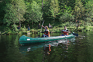 """Mary (left) and Nader (right) canoeing on a lake at the top of Mt. Fløren during the national """"go out day."""" Fløren is one of seven mountains surrounding the city of Bergen, Norway. Mary and Nader are both Syrian refugees in Norway, having both been granted political asylum. Mary, a transgender woman, arrived from Lebanon and Nader from Turkey, and the two now share apartments in the same building and attend the same language school for recently arrived refugees."""