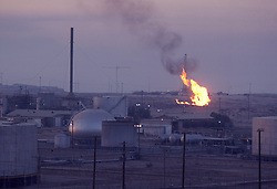 Stock photo of the Shedgum Gas Plant in Saudi Arabia at dusk