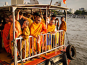 19 DECEMBER 2013 - BANGKOK, THAILAND: Buddhist monks on the back of a Chao Phraya Express Boat on the Chao Phraya River near Chinatown in Bangkok.         PHOTO BY JACK KURTZ