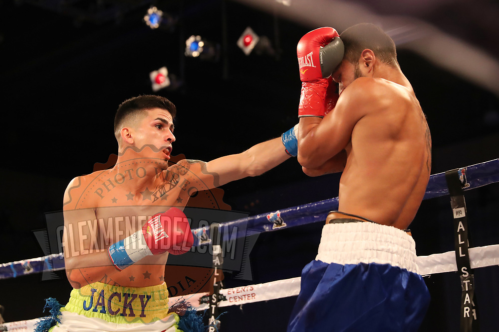 Freddy Ortiz punches Louis Rios during a Telemundo boxing match at Osceola Heritage Park on Friday, July 20, 2018 in Kissimmee, Florida.  (Alex Menendez via AP)