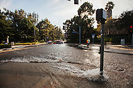 30 inch water pipe burst under Sunset blvd, producing a geyser of water that flooded the UCLA campus. Water and mud flooded the athletic area of the campus with several feet of standing water.<br /> An estimated 8 million to 10 million gallons of water was lost in the main break, according to the Department of Water and Power.