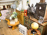 Various items on sale in antique shop, Marlesford Mill, Suffolk, England, UK