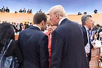 07 JUL 2017, HAMBURG/GERMANY:<br /> Emmanuel Macron (L), Praesident Frankreich, Angela Merkel (M), CDU, Bundeskanzlerin, und Donald Trump (R), Praesident Vereinigte Staatsn von America, USA, im Gesprech, vor Beginn der 1. Arbeitssitzung, G20 Gipfel, Messe<br /> IMAGE: 20170707-01-046<br /> KEYWORDS: G20 Summit, Deutschland, Gespräch