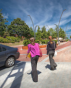 two women crossing the road in area newly landscaped by landscape architects practice
