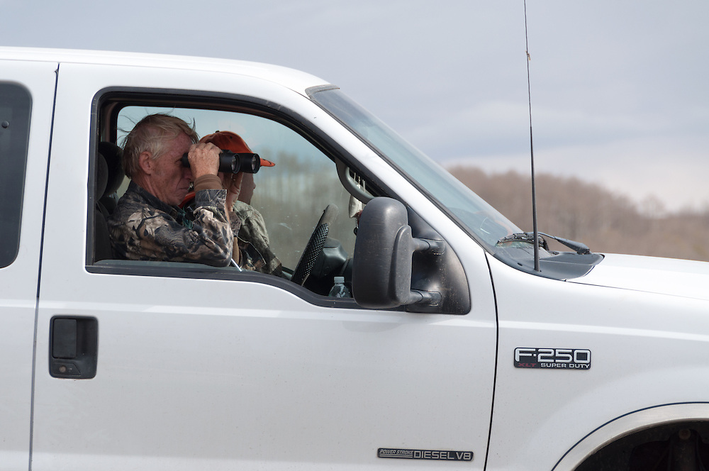 Hunters watching for wildlife from their truck in Dixie National Forest, Utah.