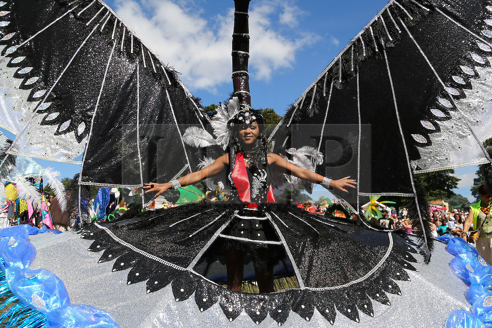 © Licensed to London News Pictures. 29/08/2016. Leeds, UK. A woman dressed in a huge colourful costume dances at the Leeds West Indian Carnival in Leeds, West Yorkshire. First run in the 1960's, the Leeds West Indian Carnival is Europe's longest running authentic Caribbean carnival parade. Photo credit : Ian Hinchliffe/LNP