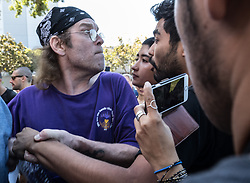 August 27, 2017 - Berkeley, California, U.S.- A Trump supporter punches an anti-right-wing protester after being pushed at MLK Jr. Civic Center Park on Sunday. (Credit Image: © Paul Kuroda via ZUMA Wire)