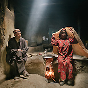 Ismaili old couple in a traditional Wakhi home. Kishmanja village, Yarkhun valley.