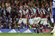 James Collins of West Ham United celebrates after scoring his sides 1st goal to make it 1-1 with his players. Premier league match, Chelsea v West Ham United at Stamford Bridge in London on Monday 15th August 2016.<br /> pic by John Patrick Fletcher, Andrew Orchard sports photography.