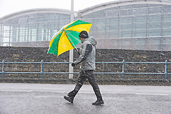 © Licensed to London News Pictures 07/02/2021.        Sevenoaks, UK. A man trying to protect himself with his umbrella from a snowy blizzard. Cold snowy weather this morning in Sevenoaks, Kent. Photo credit:Grant Falvey/LNP