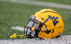 Sep 14, 2019; Morgantown, WV, USA; A West Virginia Mountaineers helmet on the field during warmups at Mountaineer Field at Milan Puskar Stadium. Mandatory Credit: Ben Queen-USA TODAY Sports