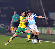 Jacob Butterfield of Huddersfield Town fights for the ball with Graham Dorrans of Norwich City during the Sky Bet Championship match at the John Smiths Stadium, Huddersfield<br /> Picture by Graham Crowther/Focus Images Ltd +44 7763 140036<br /> 17/03/2015