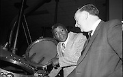 Floyd Patterson taking on the kiev:..1980-04-09.9th April 1980.09-04-1980.04-09-80..Photographed at Guinness, St James's Gate Brewery, Dublin...Floyd Patterson, twice heavyweight boxing champion of the world, and now a commissioner of the New York State Athletic Commission, examining a kiev in the central brewhouse of the St James's Gate Brewery, Dublin. He is accompanied by Justin Collins, the Visits Manager for Guinness.