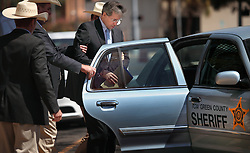 """Texas Rangers escort polygamist leader Warren Jeffs, who heads the Fundamentalist Church of Jesus Christ of Latter-Day Saints, after he was sentenced to life in prison for sexually assaulting two underage girls he claimed as """"spiritual"""" brides. The Texas jury of ten women and two men deliberated for less than an hour before giving him a life sentence for one charge and 20 years for a second, the maximum sentence for both. San Angelo, Texas, Aug. 9, 2011."""