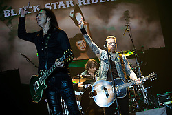 © Licensed to London News Pictures . 15/12/2015 . Manchester , UK . ROBBIE CRANE and RICKY WARWICK . Black Star Riders perform at the Manchester Arena . Photo credit : LNP