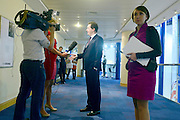 © Licensed to London News Pictures. 18/11/2012. FILE PICTURE DATED 8/10/12. Poppy Mitchell-Rose (Right) waits whilst George Osborne gives a television interview. George Osborne's long serving aide Poppy Mitchell Rose is leaving the Chancellor's office to work in the private sector in America. She is to be replaced by Thea Rogers.   Photo credit : Stephen Simpson/LNP
