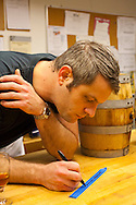 """Barrel-aged cocktails made by Clyde Common's restaurant bartender, Jeffery Morgenthaler, in Portland, Oregon.  Pictured here is Jeffery preparing 2.5 gallons of """"Remember the Maine"""" - a classic cocktail named after the USS Maine which sank in the Havana harbor in 1898, the event which precipitated the Spanish-American War.  The drink consists of Rye Whiskey, Sweet Vermouth, Cheery Heering and Absinthe."""