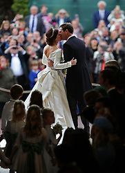 Princess Eugenie and Jack Brooksbank on the steps of St George's Chapel in Windsor Castle after their wedding.