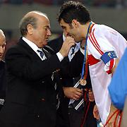 Turkey's captain Hakan Sukur receives his third place medal from Sepp Blatter