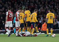 Football - 2017 / 2018 UEFA Europa League - Semi-Final, First Leg: Arsenal vs. Atletico Madrid<br /> <br /> Alexandre Lacazette (Arsenal FC) lies injured as Atletico players surround the referee after he sends of Sime Vrsaljko (Atletico Madrid) at The Emirates.<br /> <br /> COLORSPORT/DANIEL BEARHAM