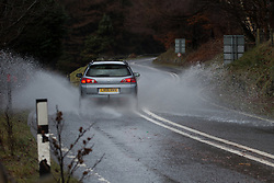 © Licensed to London News Pictures . 12/12/2014 . Blackpool , UK . Cars slowly navigate along a flooded and icy Snake Pass road in the Peak District between Manchester and Sheffield . Photo credit : Joel Goodman/LNP