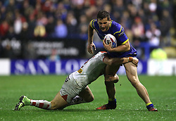 Warrington Wolves Toby King is tackled by St Helens Tom Makinson during the Betfred Super League match at The Halliwell Jones Stadium, Warrington.
