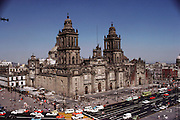 The National Cathedral in the Zocalo, the main central Square, Mexico City, Mexico. Construction was ordered by Cortez after destroying the Aztec temples which once occupied the site. It is now tilted as it sinks slowly into the lake bed Mexico City is built on.
