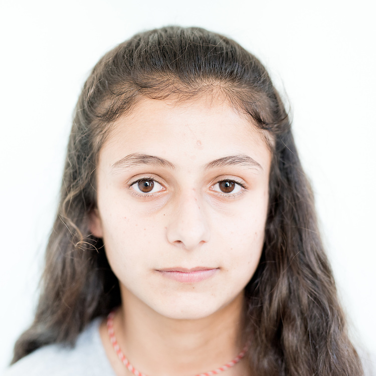 Madina Haji Qassem, a 15 year old Yazidi from Khanasor, northern Iraq.<br /> <br /> This is a series of portraits of Yazidi refugees who were stranded since April 2016 in Greece.  All of them survived the Yazidi Genocide by ISIS in August 2014 and most of them have lost family members.