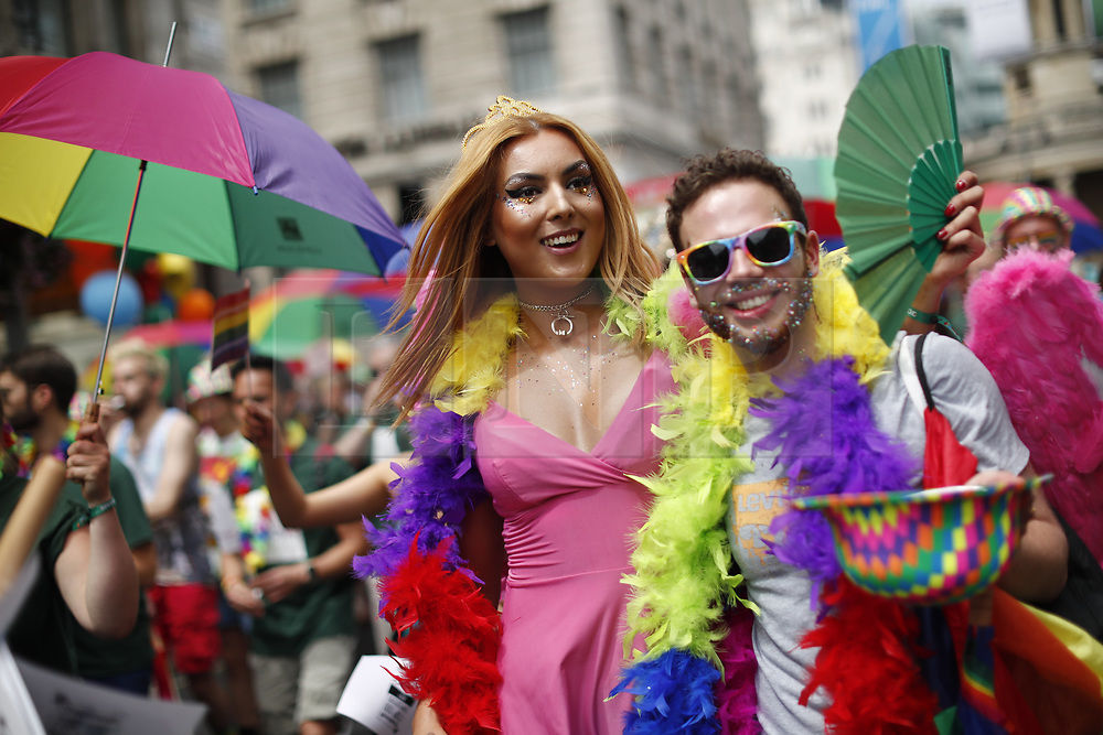 © Licensed to London News Pictures. 08/07/2017. London, UK. People march at The Pride in London Festival in central London on  Saturday, 8 July 2017 to celebrate all aspects of the LGBT+ community. The Parade attracts an estimated crowd of 1 million people and around 26,500 people take part in the march every year. Photo credit: Tolga Akmen/LNP