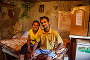 Portrait of Ivan Kaleja (26) and his wife Klara (22) in the living room of their house. Ivan is longterm unemployed and as many other residents in the settlement the family is living on social welfare and occasional jobs. For years Ivan is struggling to find work in the region.