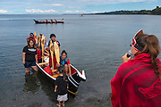 Paddlers in the native Canoe Journey are welcomed to Port Angeles' beach by the Lower Elwha Tribe. 78 canoes participated, joining each other as tribes entered the route along the way, and included representatives from tribes as far away as Montana and even New Zealand.<br /> <br /> The various canoe routes are from both sides of Vancouver Island, Georgia Strait, and the Olympic Peninsula.<br /> <br /> All the canoes are hand carved dugouts. Many carry tribal talismans, or have other hand made decorations that carry meaning for the tribal members.
