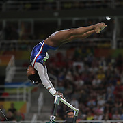 Gymnastics - Olympics: Day 6  Simone Biles #391 of the United States in action during her Uneven Bars routine during her gold Medal performance in the Artistic Gymnastics Women's Individual All-Around Final at the Rio Olympic Arena on August 11, 2016 in Rio de Janeiro, Brazil. (Photo by Tim Clayton/Corbis via Getty Images)
