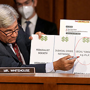 Sen. Sheldon Whitehouse (D-R.I.) makes a presentation during his questioning of President Donald Trump's Supreme Court nominee Judge Amy Coney Barrett during the second day of her Senate Judiciary Committee confirmation hearing Tuesday, October 13, 2020.