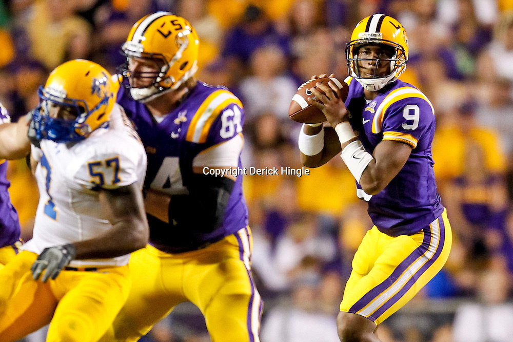 October 16, 2010; Baton Rouge, LA, USA; LSU Tigers quarterback Jordan Jefferson (9) throws a pass against the McNeese State Cowboys during the first half at Tiger Stadium.  Mandatory Credit: Derick E. Hingle