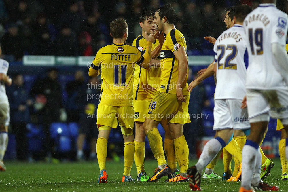 Alfie Potter (11) of Oxford United celebrates with his teammates after scoring his teams 1st goal. The FA Cup, 2nd round replay, Tranmere Rovers v Oxford United at Prenton Park in Birkenhead, England on Tuesday 16th December 2014.<br /> pic by Chris Stading, Andrew Orchard sports photography.