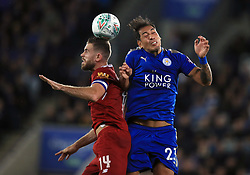 Liverpool's Jordan Henderson (left) and Leicester City's Leonardo Ulloa battle for the ball during the Carabao Cup, third round match at the King Power Stadium, Leicester.