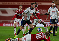 Middlesbrough's Duncan Watmore lies prostrate as Luton Town's Sonny Bradley wins the ball from Middlesbrough's Chuba Akpom<br /> <br /> Photographer Alex Dodd/CameraSport<br /> <br /> The EFL Sky Bet Championship - Middlesbrough v Luton Town - Wednesday 16th December 2020 - Riverside Stadium - Middlesbrough<br /> <br /> World Copyright © 2020 CameraSport. All rights reserved. 43 Linden Ave. Countesthorpe. Leicester. England. LE8 5PG - Tel: +44 (0) 116 277 4147 - admin@camerasport.com - www.camerasport.com