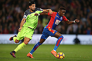 Emre Can of Liverpool intercepts Wilfried Zaha of Crystal Palace. Premier League match, Crystal Palace v Liverpool at Selhurst Park in London on Saturday 29th October 2016.<br /> pic by John Patrick Fletcher, Andrew Orchard sports photography.