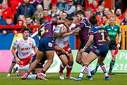 Hull Kingston Rovers centre Junior Vaivai (2) is stopped by Leeds Rhinos  players during the Betfred Super League match between Hull Kingston Rovers and Leeds Rhinos at the Lightstream Stadium, Hull, United Kingdom on 29 April 2018. Picture by Simon Davies.