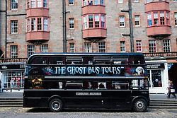 Tourist Ghost Tour double decker bus on the Royal Mile in Edinburgh Scotland, United Kingdom,