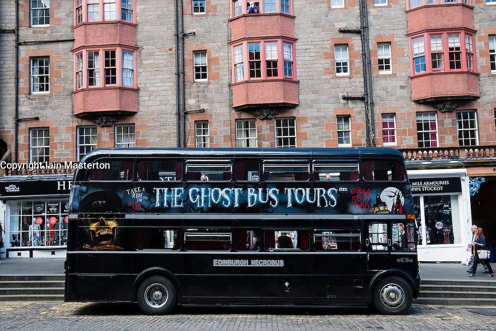 Tourist Ghost Tour double decker bus on the Royal Mile in Edinburgh Scotland, United Kingdom,