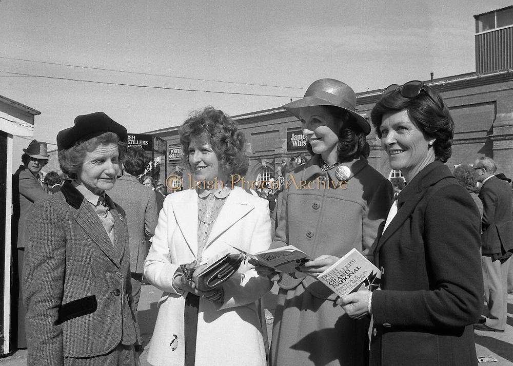 "Irish Distillers Grand National at Fairyhouse.  (M66)..1979..16.04.1979..04.16.1979..16th April 1979..The Irish Distillers Grand National was run today at Fairyhouse Racecourse, Co Meath.The race over 3.5miles is valued at £20,000. the winning trainer will also receive the Tom Dreaper,Perpetual Trophy which will be presented by Mrs Betty Dreaper..Pictured at the Fairyhouse race meeting were, (L-R), Mrs Frank O'Reilly, Mrs Richard Burrows, Mrs Michael O'Kennedy and Mrs Archie Cook..Pictured receiving his winners trophy is Anthony Robinson,Owner and rider of ""Tied Cottage"",The presentation was made by Mrs Michael O'Kennedy. Includer are Mr Richard Burrows,MD,Irish Distillers Ltd, Mrs Betty Dreaper and mrs Joan Moore,wife of the winning trainer."