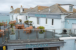 © Licensed to London News Pictures; 11/06/2021; St Ives, Cornwall UK. G7 summit in Cornwall. General views of the Pedn Olva hotel on St Ives sea front which is temporarily closed. It has been reported that the hotel hosting media and security staff for the G7 has closed  on Thursday following a coronavirus outbreak, with the owners St Austell Brewery confirming that a number of their team at the hotel tested positive for Covid-19. Photo credit: Simon Chapman/LNP.